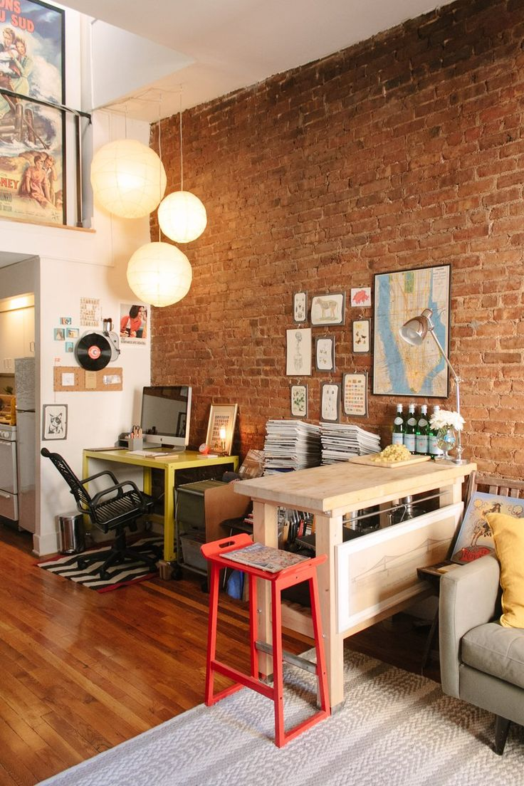CB's Quirky & Personal Duplex The office area is delineated helpfully by a visual separation and separate overhead lighting.