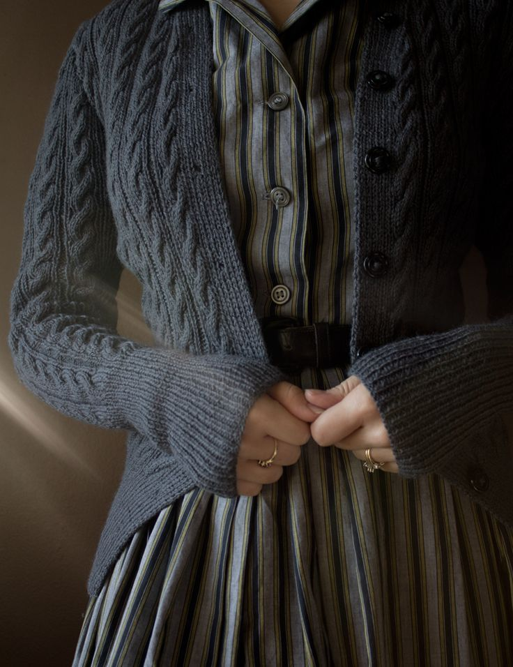 Love the look with the sweater and dress.
