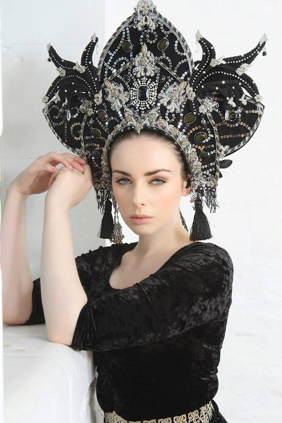 The Dark Iris headdress is an opulent piece, made from a base of black velvet, intricately beaded with silver sequins, metal braid, applique and