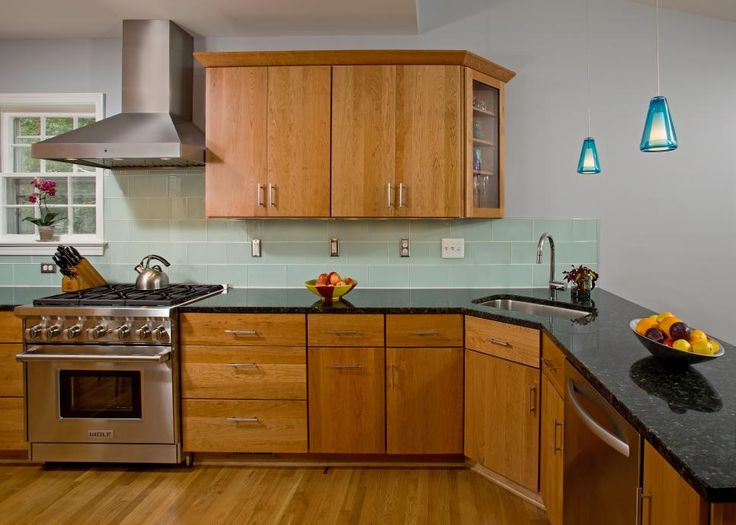 In This Kitchen Pretty Wood Cabinets And Granite