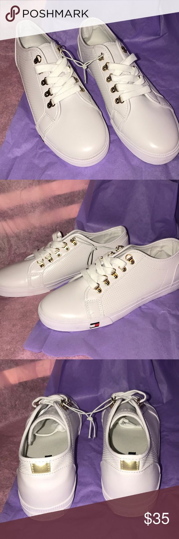 NWOT Tommy Hilfiger Sneakers New without tags, white with gold hardware Tommy Hilfiger sneakers. Size 10. Used as display model, and tried on a few times. Perfect with jeans or with a casual dress! Tommy Hilfiger Shoes