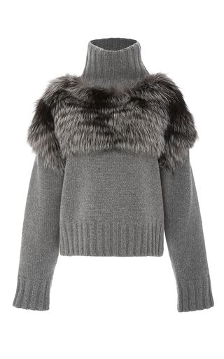 This **Sally LaPointe** pullover features a turtleneck and a relaxed fit.