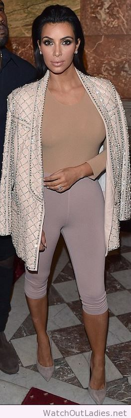 Kim Kardashian nude beaded blazer, pink leggings, tan shirt, and suede pumps