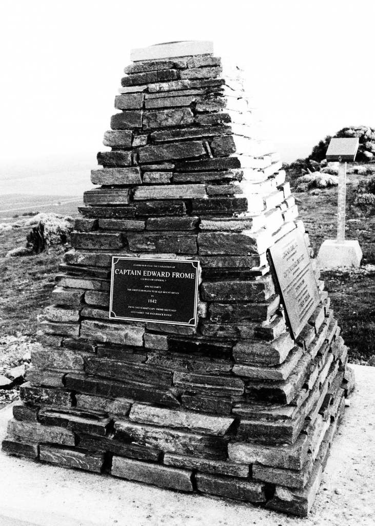 Commemoratung the expedition of Captain Edward From, Surveyor General, and his party. The first Europeans to scale Mount Bryan in 1842. From this summit Captain Frome sketched and named 'The Razorback Range' -- plaque on Mt Bryan Summit