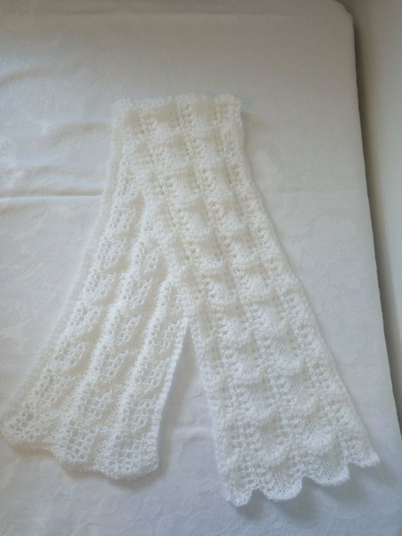 Stunningly beautiful hand knitted Shetland crest of a wave lace style scarf in Winter white with a shimmer strand running through it. This is a light weight scarf for those who dislike bulky scarves around their neck or to wear in the spring when its not as cold. The scarf is approx 46ins in length and has a scalloped edging. If you would like this in a different colour please state which one when ordering.