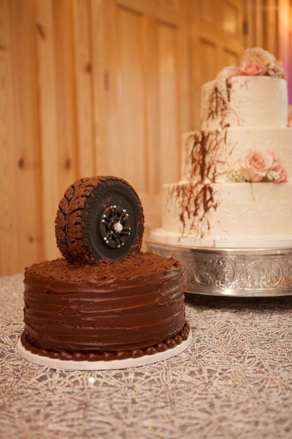 a different groom's cake off an off road tire covered in chocolate mud  - thereddirtbride.com - see more of this wedding here
