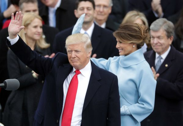 Melania Trump Photos Photos - U.S. President Donald Trump and his wife Melania Trump wave after he took the oath of office on the West Front of the U.S. Capitol on January 20, 2017 in Washington, DC. In today's inauguration ceremony Donald J. Trump becomes the 45th president of the United States. - Donald Trump Is Sworn In As 45th President Of The United States