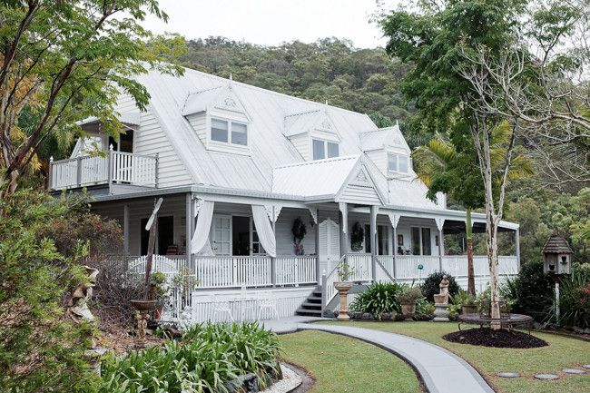 Dulux Antique White USA covers the exterior of the house, while Dulux Elephant Grey was used on the verandah and...
