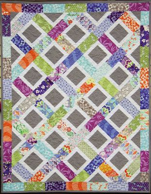 Good Fortune Charm Quilt - made by cutting squares in half and adding solid grey centres and some white