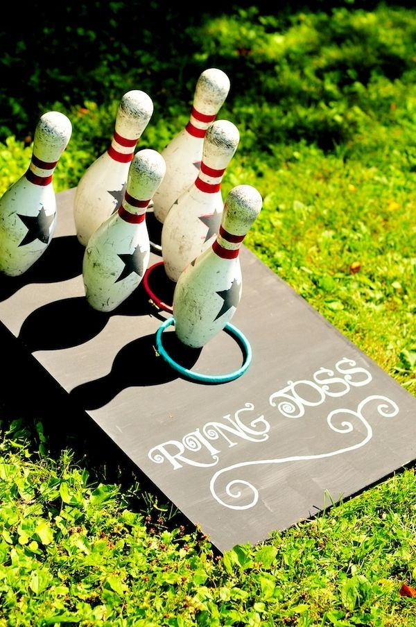 """Meg and Carrie hosted a casual carnival-themed wedding in Meg's parent's backyard in New Hampshire, proving that backyard weddings can be kick-ass for budget and scenery. (Seriously, the greenery is making me long for warmer weather!) Plus, they put a really fun spin on a ring warming ceremony by making it """"interactive."""" Read on to see how they did it."""