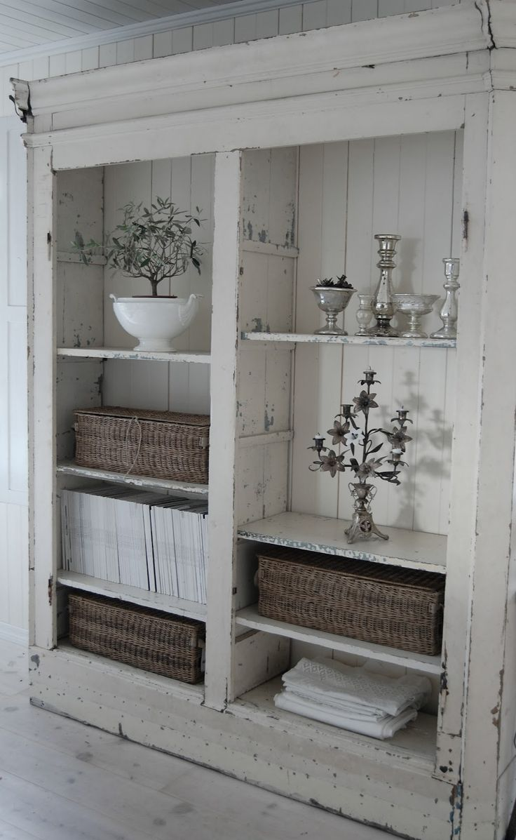 I love this rustic white shelving unit.