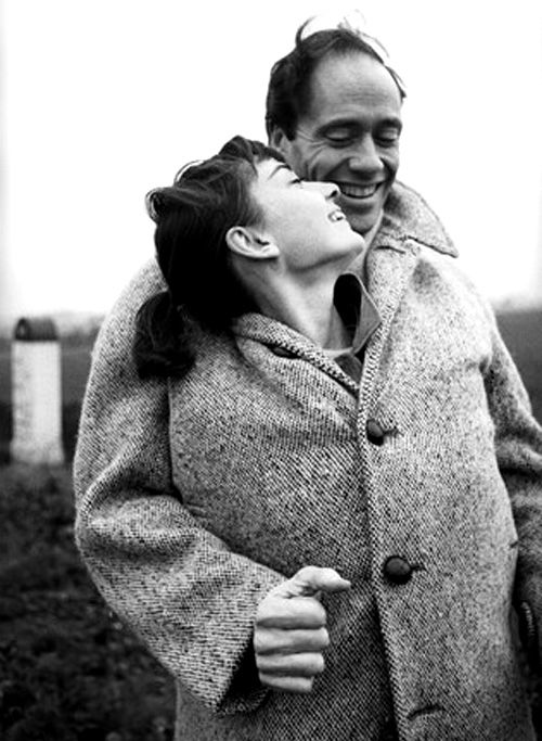 """Audrey Hepburn and husband Mel Ferrer stop to take pictures on a country road outside Paris, 1956. Photographs by Michael Ochs. """"One of my absolute favorites,"""" said Sean Ferrer."""