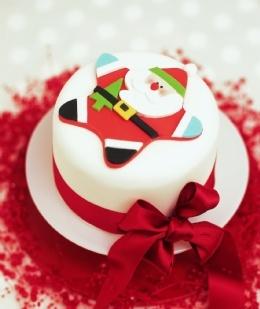 Close Up of Star Santa Christmas Cake Decoration