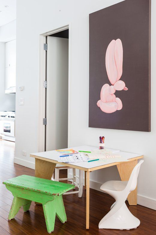 A balloon-bunny painting by Jen Wink watches over a favorite family spot: the kids' own art table.