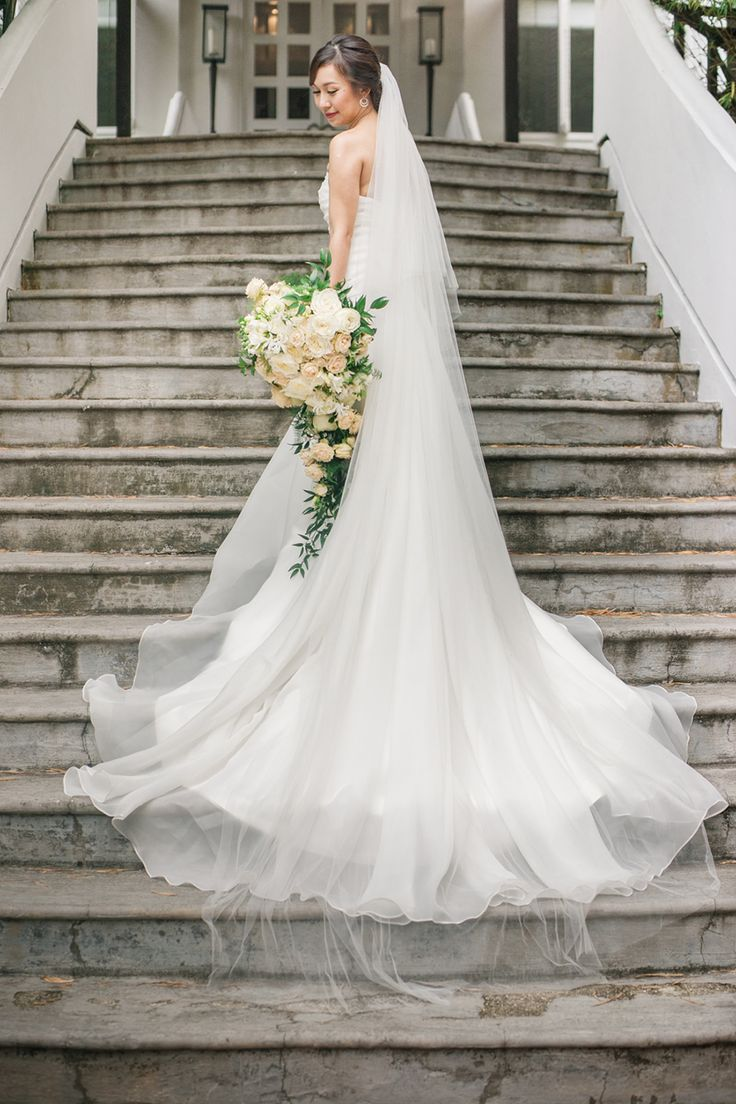 Cascading teardrop wedding bouquet inspired by Princess Diana's bridal bouquet {Facebook and Instagram: The Wedding Scoop}
