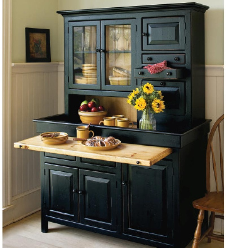 Large Conestoga Cupboard inspired by Hoosier-style farm kitchens. Pull-out serving shelf, dry sink top, and glass door cabinets to display your favorite crockery recreate the old-time charm