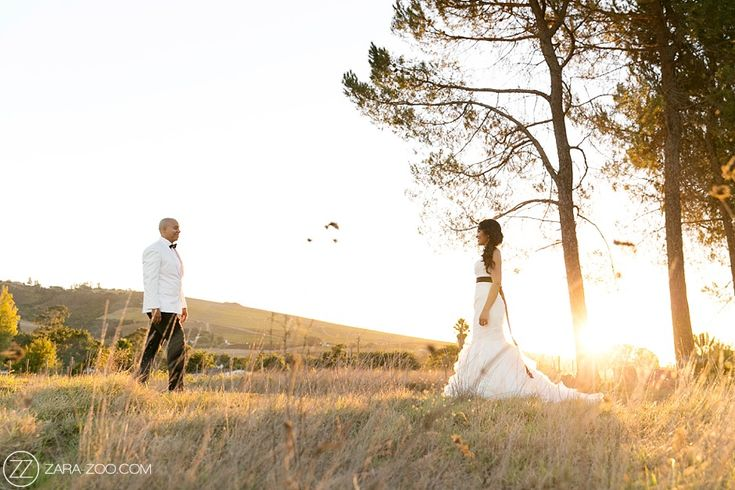 Bride wearing a #VeraWang #wedding dress. Groom wearing a white tux with a black bow tie. #Nooitgedacht Estate, Stellenbosch. ZaraZoo Photography