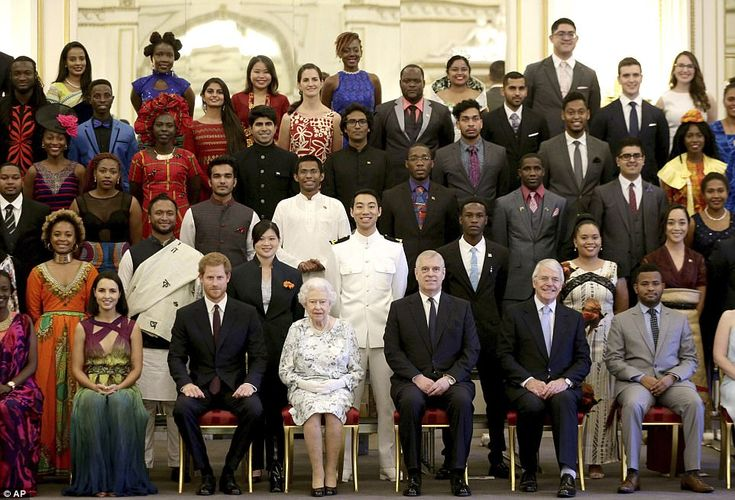 Winners sit for a group photo with the Queen (centre, with Harry, Andrew and former PM Joh...