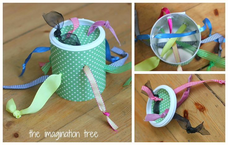 Ideas in this link:  DIY baby and toddler ribbon pull toy Popsicle Stick In-Out Toy Lid Drop Toy