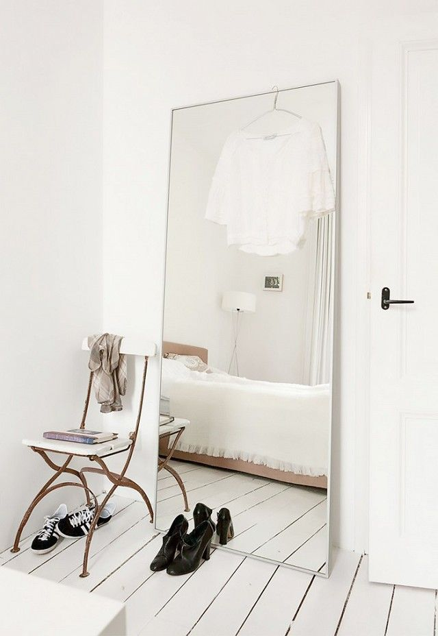 Minimalist bedroom with a large mirror