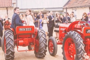 Tractors to take us from the ceremony to reception were a perfect choice for our country wedding theme.