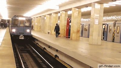 Russian stunt guy jumps and flips over in front of subway train   Gif Finder – Find and Share funny animated gifs