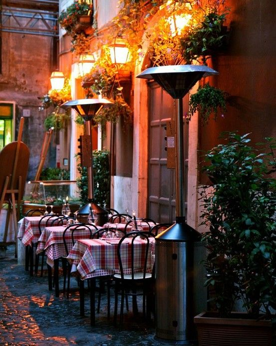 Outdoor eating in Rome, Italy…how very romantic.