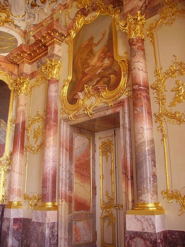 This German interior is influenced by Rococo design style. The pinks, roses, and gold adornments are true of this time period.