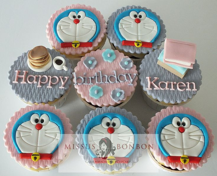 Doraemon cupcakes for Karen's birthday!  She loves Doraemon, pastel colors and is a teacher, so we made these themed cupcakes.