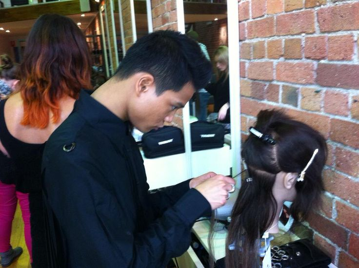 Teaching a student on Great Lengths Hair Extensions