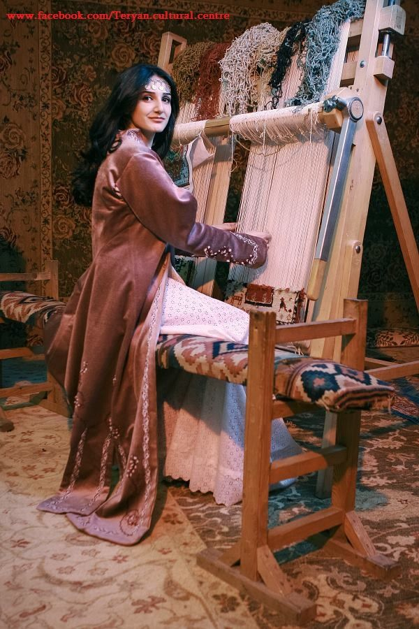 Armenian traditional costume. Weaving was considered a traditional art. In many cultures the artist would intricately weave the tales of folklore into the rugs and clothes. Today this form of art is considerent almost extinct.