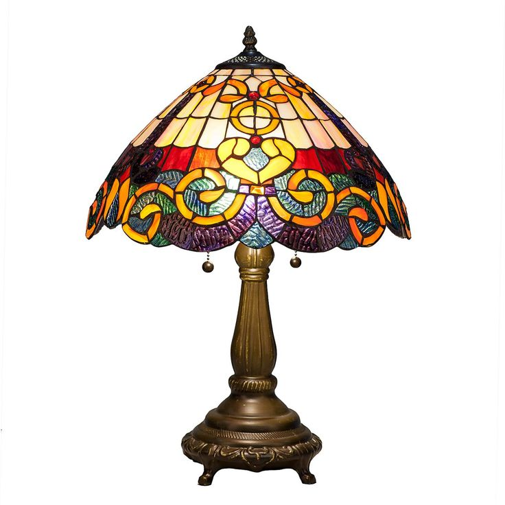 Bask in the warm glow of this Tiffany-style table lamp. A bronzy base and striking stained glass in earthy tones harken back a century, providing a beautiful contrast to contemporary furnishings or a lovely complement to classic spaces.