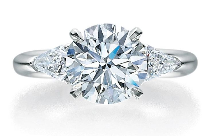 Jb Star Round Brilliant engagement ring.  Check out our blog about buying a diamond.