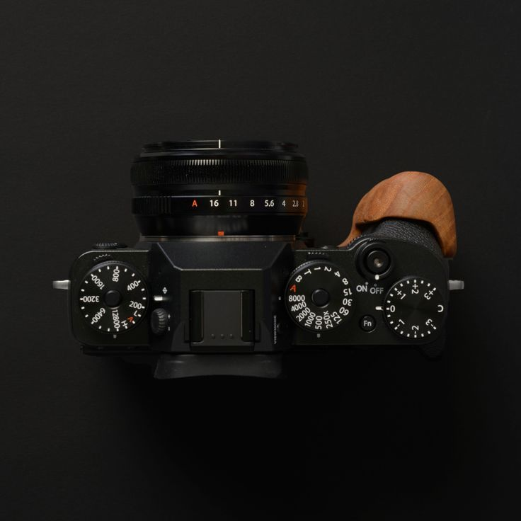 Fujifilm X-T2 camera with a Holzgriff wooden camera grip