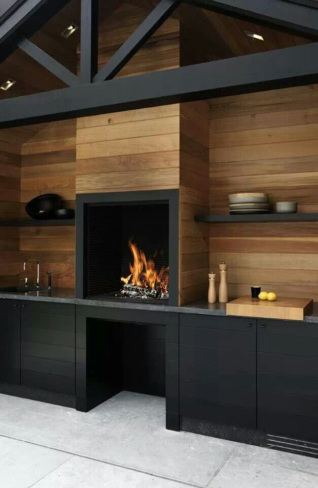 Outdoor kitchen. This design would work well at a modern or newly restored mountain chalet.