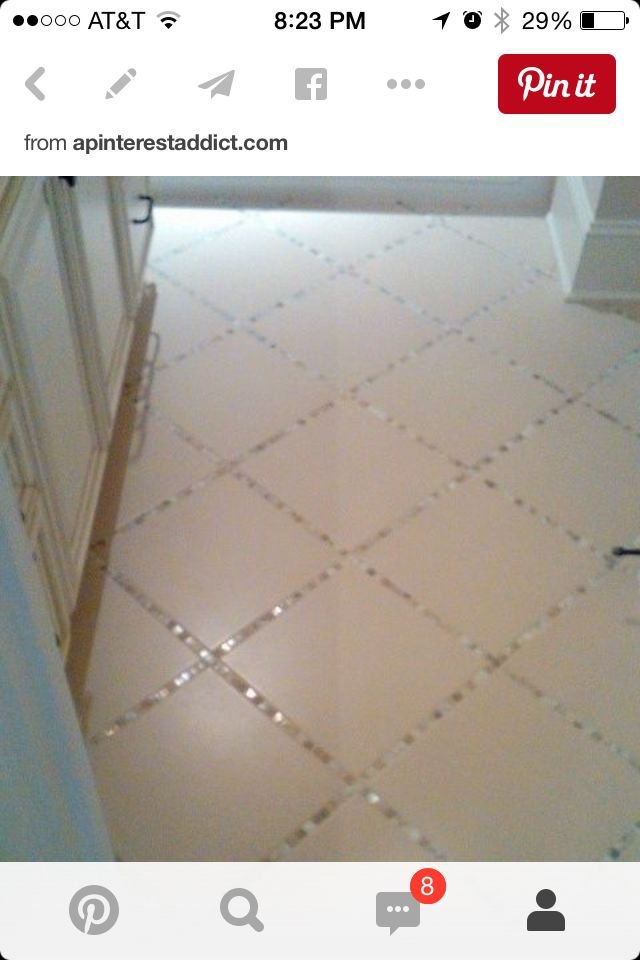 I'd use black larger tiles with dark irredescent tiles in between.....