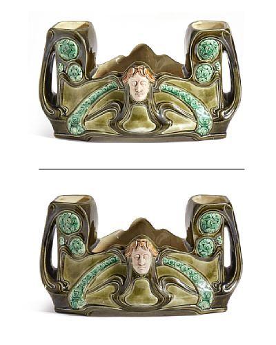 ANDREAS OLLESTAD 1857 - 1936  Jardiniere Egersund Fajanse. Art Nouveau/ Jugend. 1900-tallets begynnelse. Grønnglasert fajansegods. HØYDE 17,00 CMLENGDE 32,00 CM DYBDE 17,00 CM