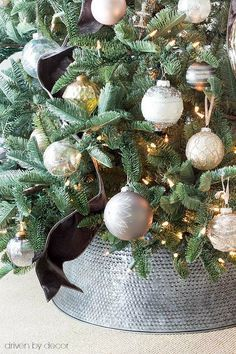 Love this metal tree collar (a HomeGoods find!) used instead of a traditional Christmas tree skirt! (sponsored pin)