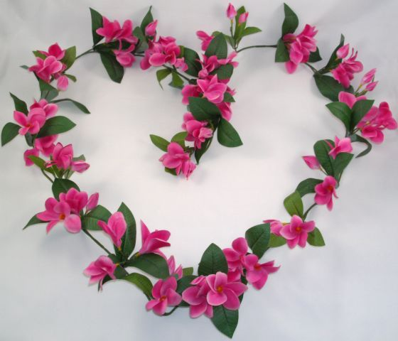 Frangipani Garland in Pink complete with bendable wire stem.