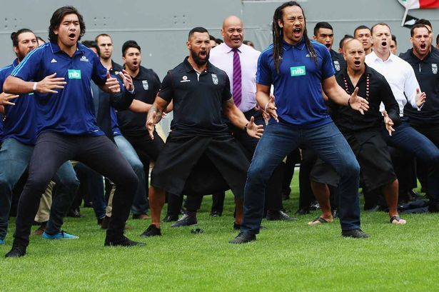 Former and current union and league players, Steven Luatua, Ruben Wiki and Tana Umaga perform a haka at the memorial