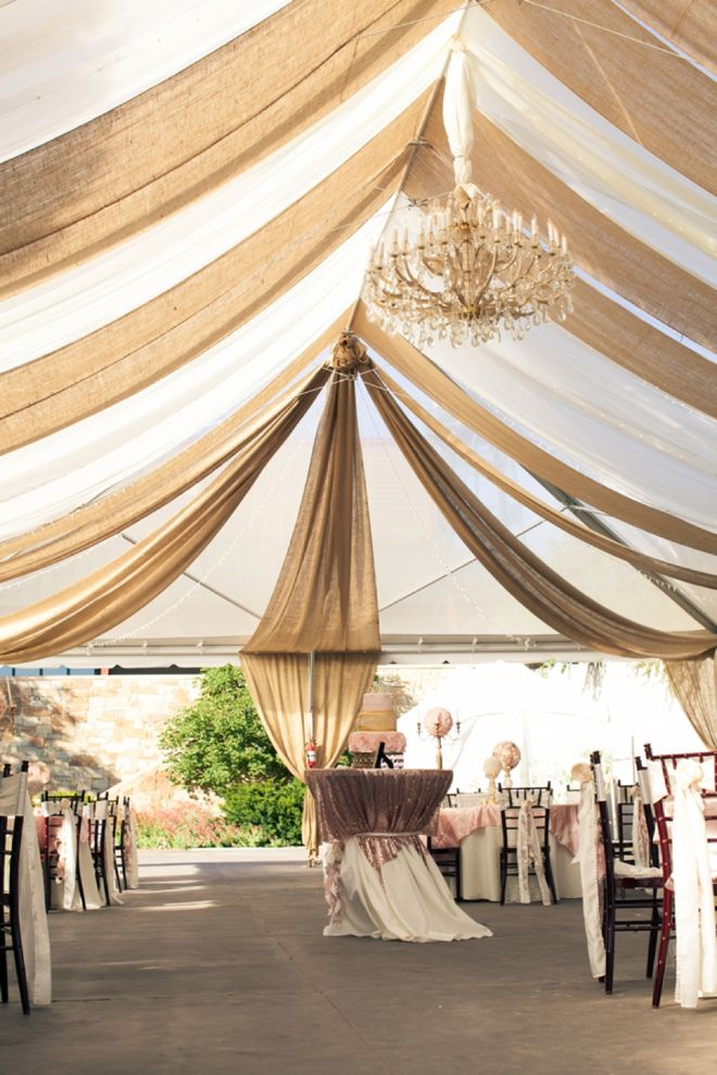 Burlap and linen tent drape! The bride mom DIY-ed this!! Image: Carrie Butler Photography