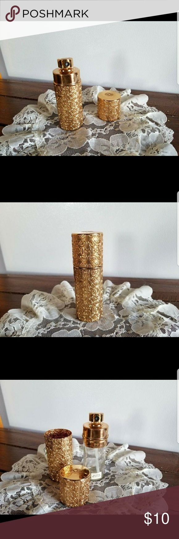 """Vintage Gold Tone Refillable Perfume Bottle Beautiful Vintage gold tone reusable perfume bottle. Gorgeous detailing, marked made in the USA on the bottom. The bottle reads Bellodgia 2oz. It stands 5"""" tall and 1.5"""" wide. Makeup"""