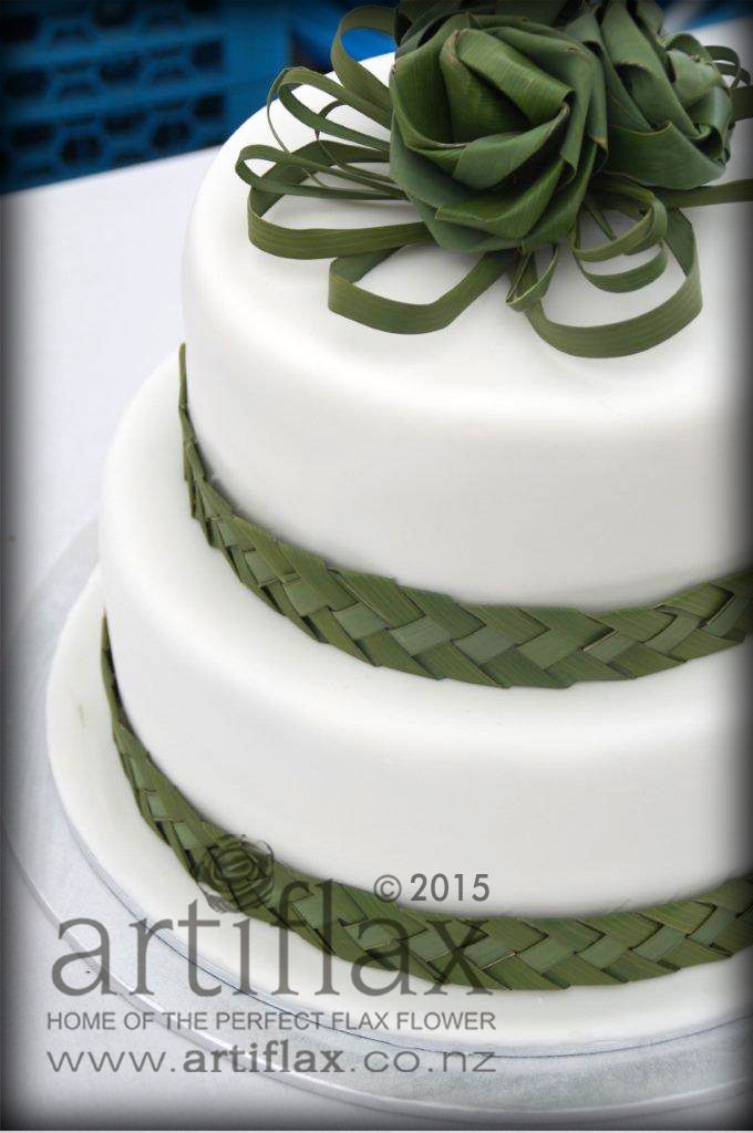 Natural green flax cake topper and woven natural green flax  ribbon to wrap around each tier....by Artiflax