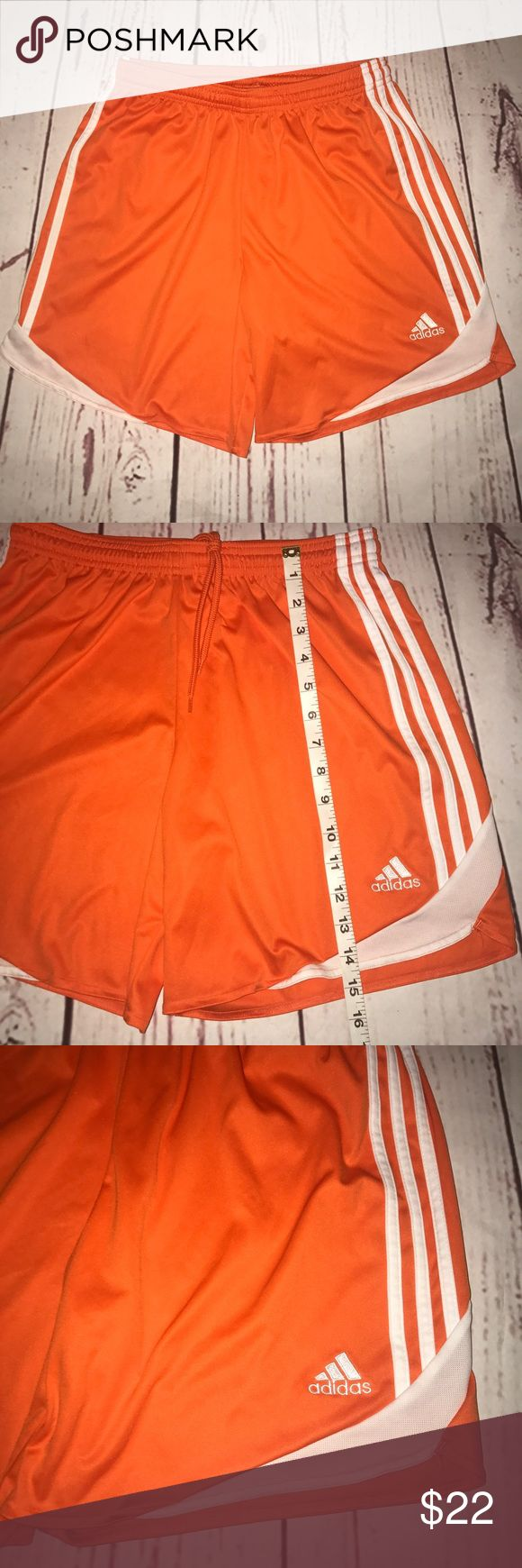 ADIDAS ORANGE MEDIUM ATHLETIC BASKETBALL SHORTS ADIDAS! Women's size medium. Tag has been cut out. Please check out the measurements in the photos. There is an elastic waistband with drawstring. Orange shorts with white stripes and logo! adidas Shorts