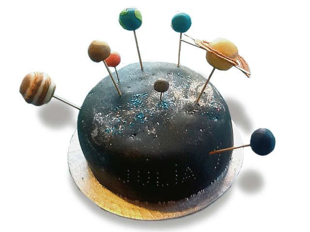 solar system cake - half dome cake dyed as the sun and have rice crispy balls for the planet
