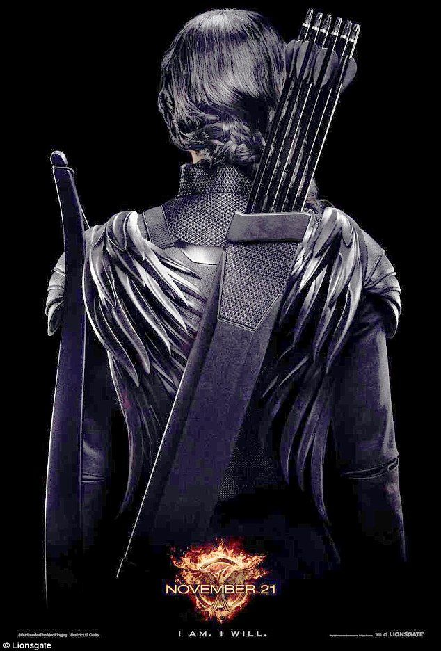 Dark and deadly: Jennifer Lawrence dons black leather as Katniss in the latest poster from The Hunger Games: Mockingjay - Part 1 released on Thursday
