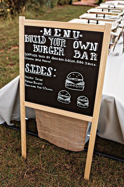 A buffet is casual and laid-back, just like your backyard. Besides, who doesn't love a good burger? Give your guests a peek at the comfort foods that await them by writing the menu on a chalkboard.Related:50 Fun Menu Innovations for Your Reception
