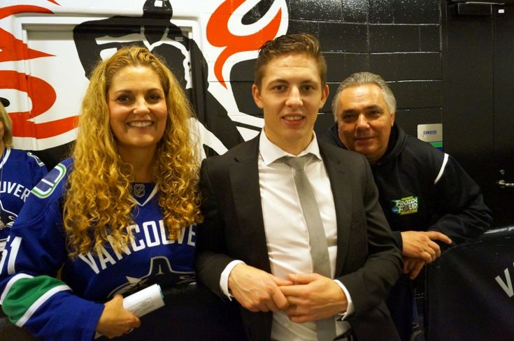 Troy Stecher is flanked by his mother Tracey and father Peter after his first game with the Vancouver Canucks. Stecher was named the game's third star in a 3-0 loss against the Ottawa Senators on Oct. 25, 2016.