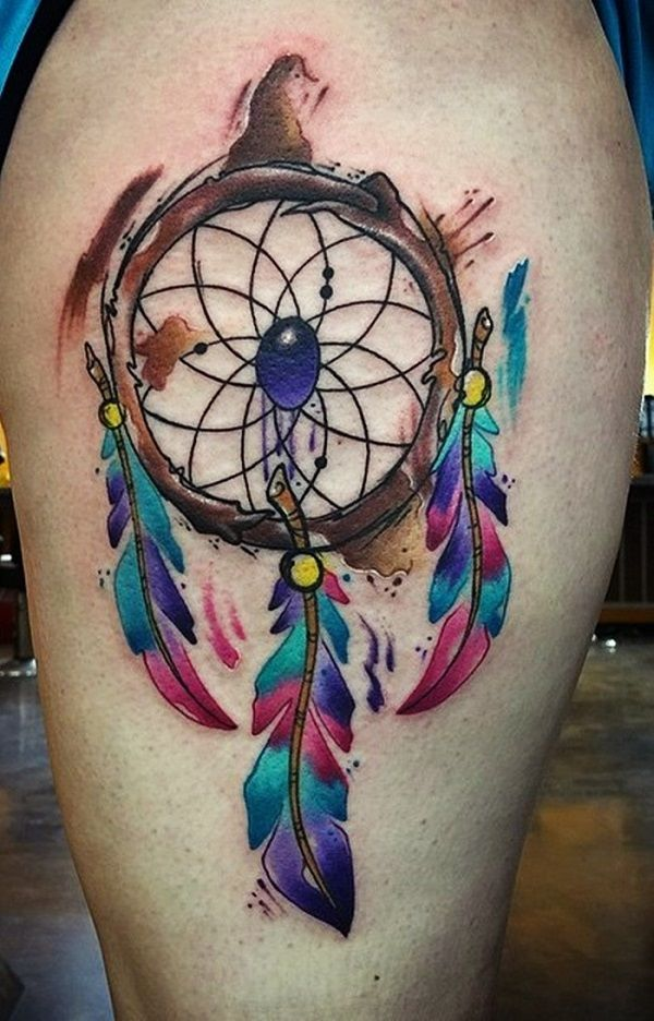 The Gem within the Dreamcatcher's Hoop. A gem beaded inside the flowery mosaic depicts good luck within financial career. 3 multi- colored feathers hanging also adds to the value of this tattoo design.