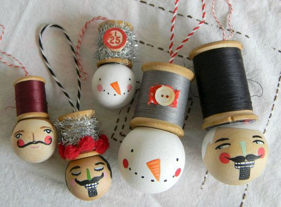 this is for ONE ornament... the smaller nutcracker gentleman on the left side (in the first photo!) he wears a very festive spool hat decorated with tinsel and red pompoms! handmade ornament featured in the current issue of Amy Powers Inspired Ideas magazine! made from a vintage spool